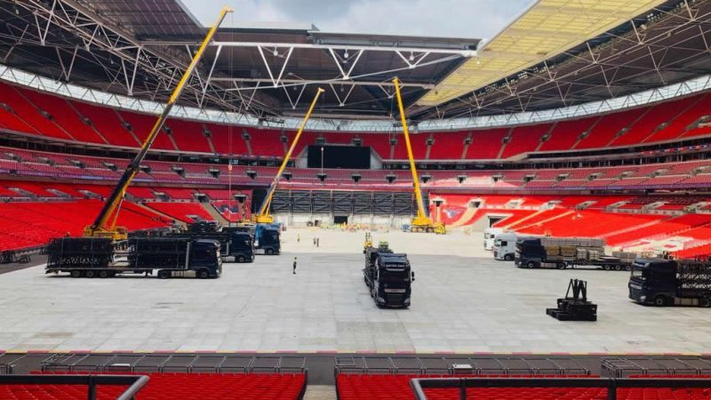Stage hands unloading trucks in Wembley Stadium