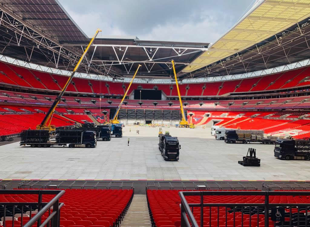 Stage hands unloading trucks in Wembley Stadium